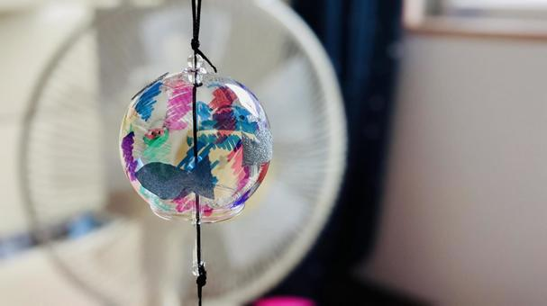 Image of summer Wind chimes and electric fans
