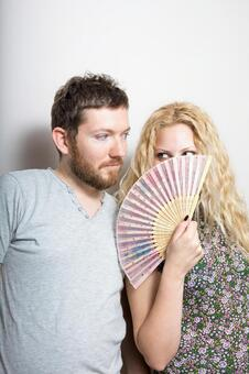 A woman with a fan and a foreigner man 4