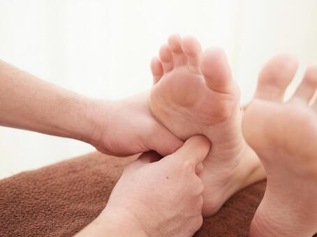 Japanese woman receiving foot massage