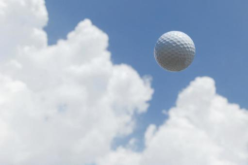 Golf ball in the blue sky