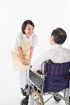 A nurse and a wheelchair male 14