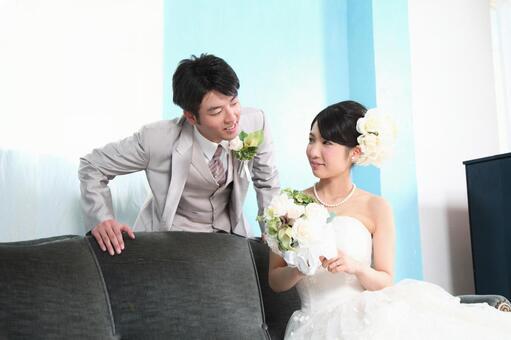 Brides and bridegroom sitting on the sofa 4