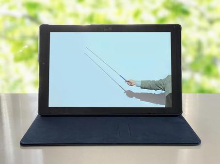 Online lessons on a tablet in the fresh green