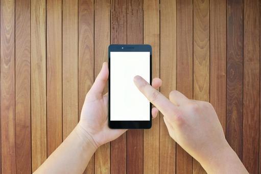 智能手机,手和桌子