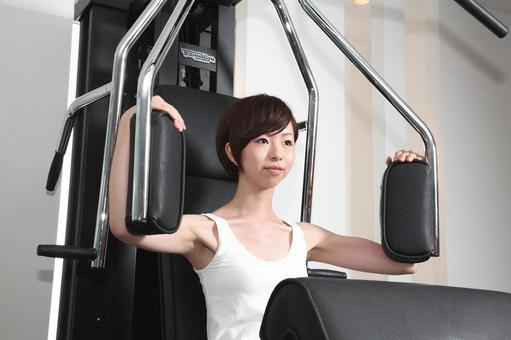 A woman using a training machine 10