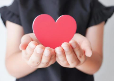 Image of child's palm and heart
