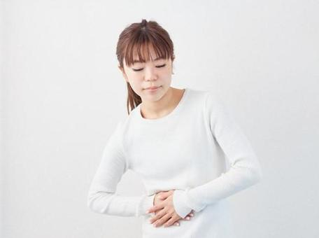 Asian woman with a stomachache