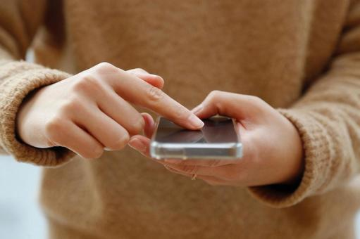 Person who manipulates smartphone with index finger 1