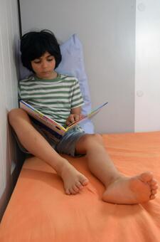 Spanish boys sitting and reading books 4