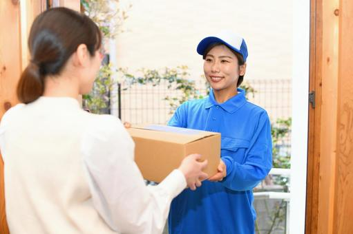 Female driver wearing work clothes to deliver luggage (courier service)