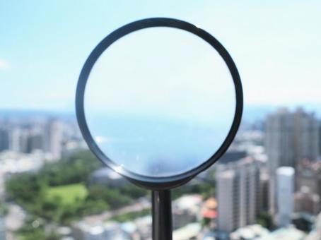 Townscape and magnifying glass House search Real estate