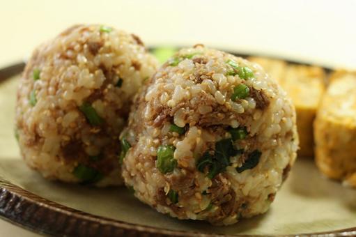 Brown rice ball onigiri with cow sotetsu