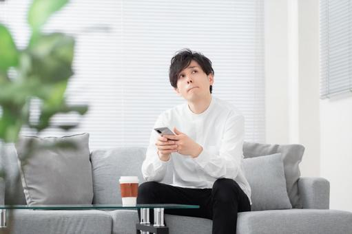 Image of a man operating a smartphone