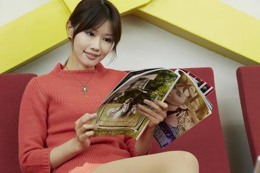 A woman watching a magazine 17