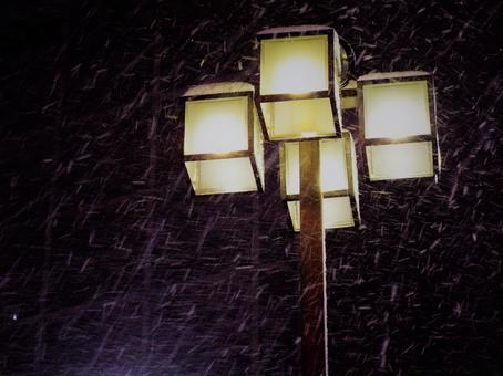 Snow and street light