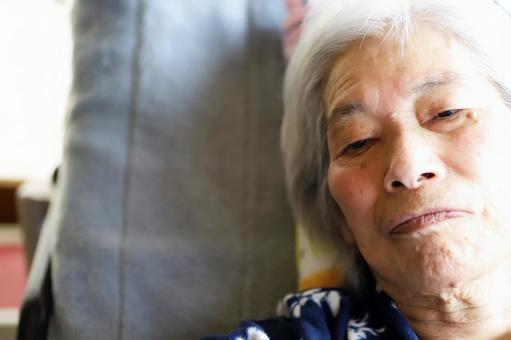 Close-up of face facing senior woman lying in nursing bed