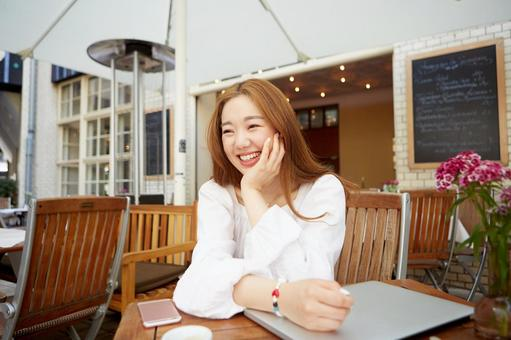 Asian woman 5 with cheek stick in cafe