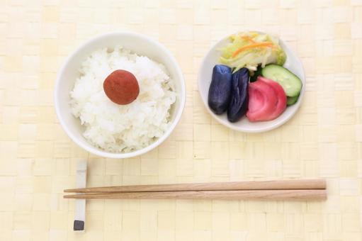 White rice cooked and Umeboshi and pickles