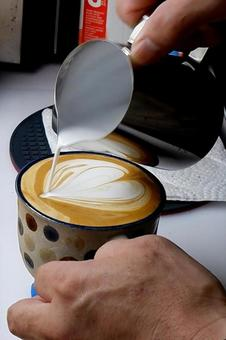 Barista cup up in heart latte art