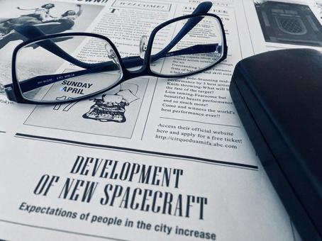 English newspaper, eyeglasses, eyeglass case
