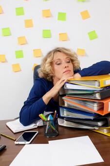 Working mother at work at the desk in front of the wall with many sticky notes 10