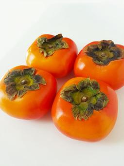 Four sweet autumn persimmons 102