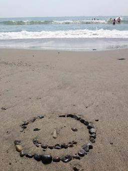 Smile Smile Smile Nico Nico Draw a picture with stones Sandy beach Nature play Summer landscape Vertical image