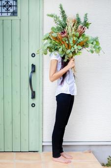 Woman with a bouquet of leaves