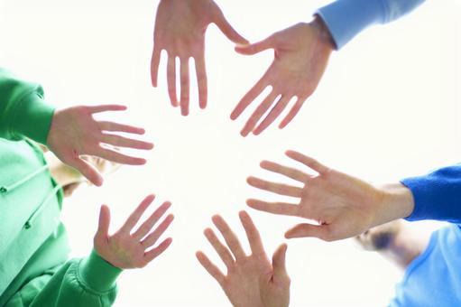 Volunteer 3 people holding both hands