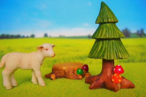 미니어처의 어린 양고기와 초원이있는 풍경