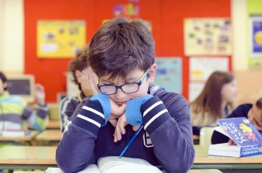 Boy studying in the classroom 17
