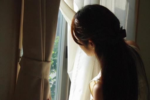 A girl looking through the window
