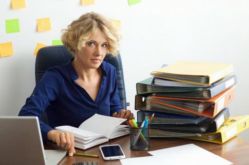 Working mother at work at the desk in front of the wall with many sticky notes 13