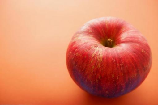 Apples and brown background