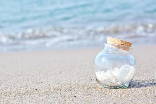 A small bottle on the beach