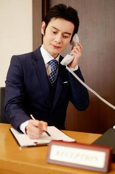 Hotel Man 3 receiving a call
