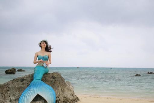 Sea of Ishigaki Island Mermaid sitting on a rock by the seaside