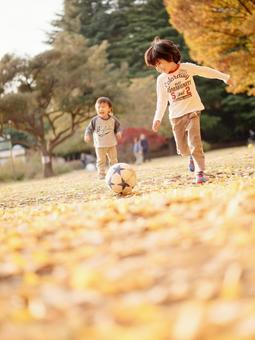 Brothers playing soccer