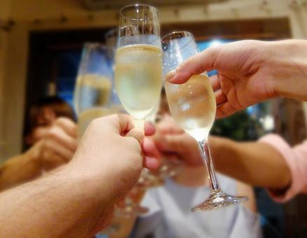 Toast with champagne with friends gathered at the party