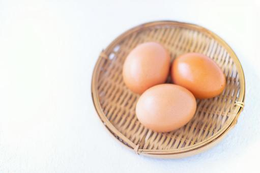 Three eggs on a colander Red ball