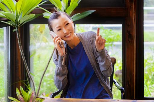 Woman talking on smartphone_pointing