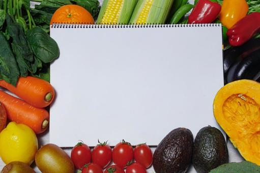 Sketchbook and vegetable copy space