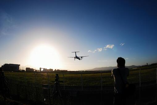 Sunset and propeller plane