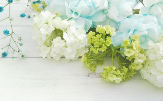 Hydrangea and blue carnation wood grain background