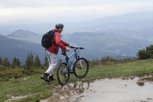 Men going by mountain path by bicycle 14