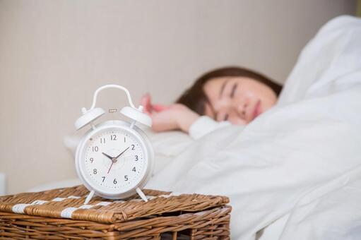 Sleeping woman (focus on the clock)