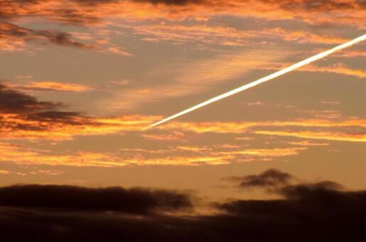 Dusk and airplane cloud