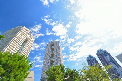 High-rise apartment and blue sky