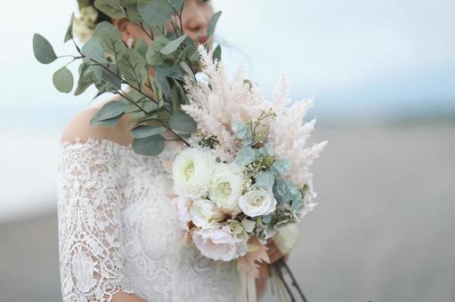 White wedding bouquet and white wedding dress