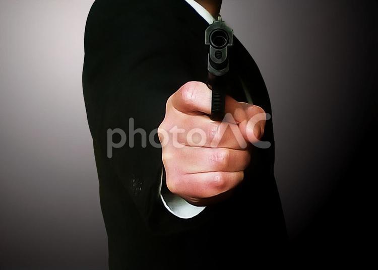 ピストル 男性の写真